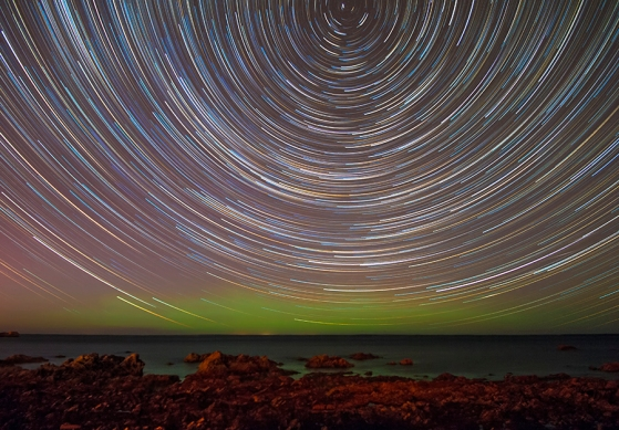 A long exposure shows startrails about the North celestial pole.